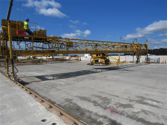 Installation of Latex Modified Concrete (LMC) wearing surface on the I-95 Southbound Q-Bridge East Approach Structure