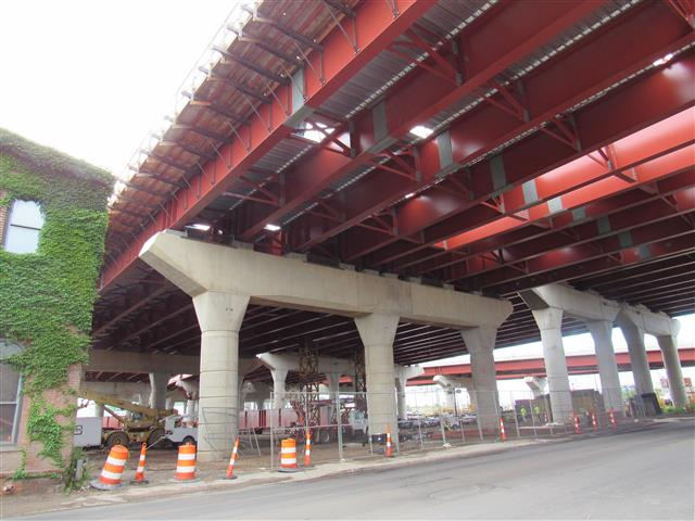 Newly erected structural steel with concrete deck forms of the I-95 Southbound Q-Bridge West Approach Structure over East Street