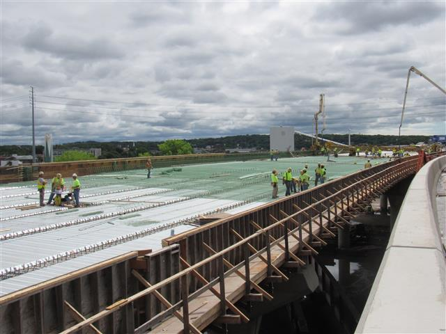 Installation of corrugated deck forms and steel reinforcement of the I-95 Southbound Q-Bridge West Approach Structure