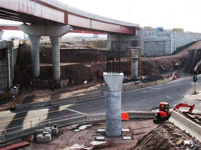 View looking east at the construction of concrete piers that will support the I-91 SB to Route 34 WB bridge over Water Street