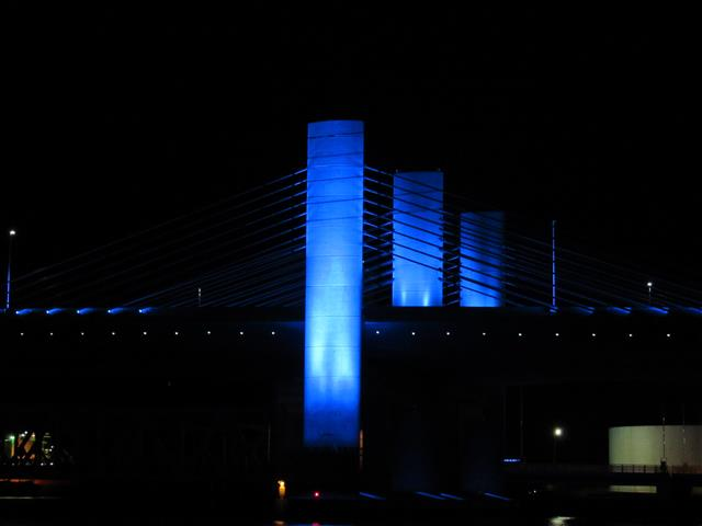 The Bridge will be lit in hues of blue and green year-round, with the exception of certain designated memorial days for which memorial lighting will be implemented.