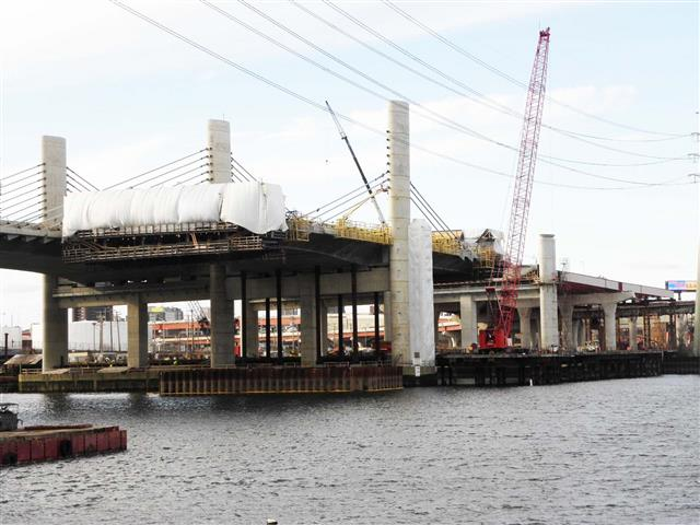 Ongoing segmental bridge construction at the I-95 Southbound Pearl Harbor Memorial (Q) Bridge Tower Pier TP-2. Note enclosure for placement of concrete during cold weather.